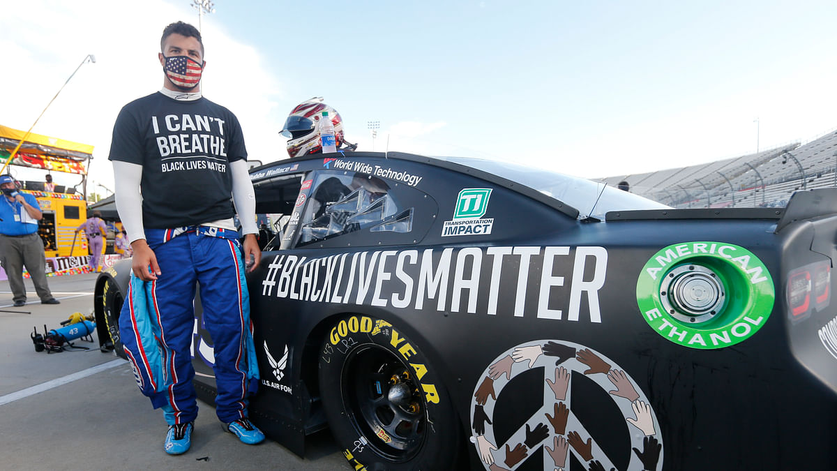 Driver Bubba Wallace waits for the start of a NASCAR Cup Series auto race Wednesday, June 10, 2020, in Martinsville, Va.
