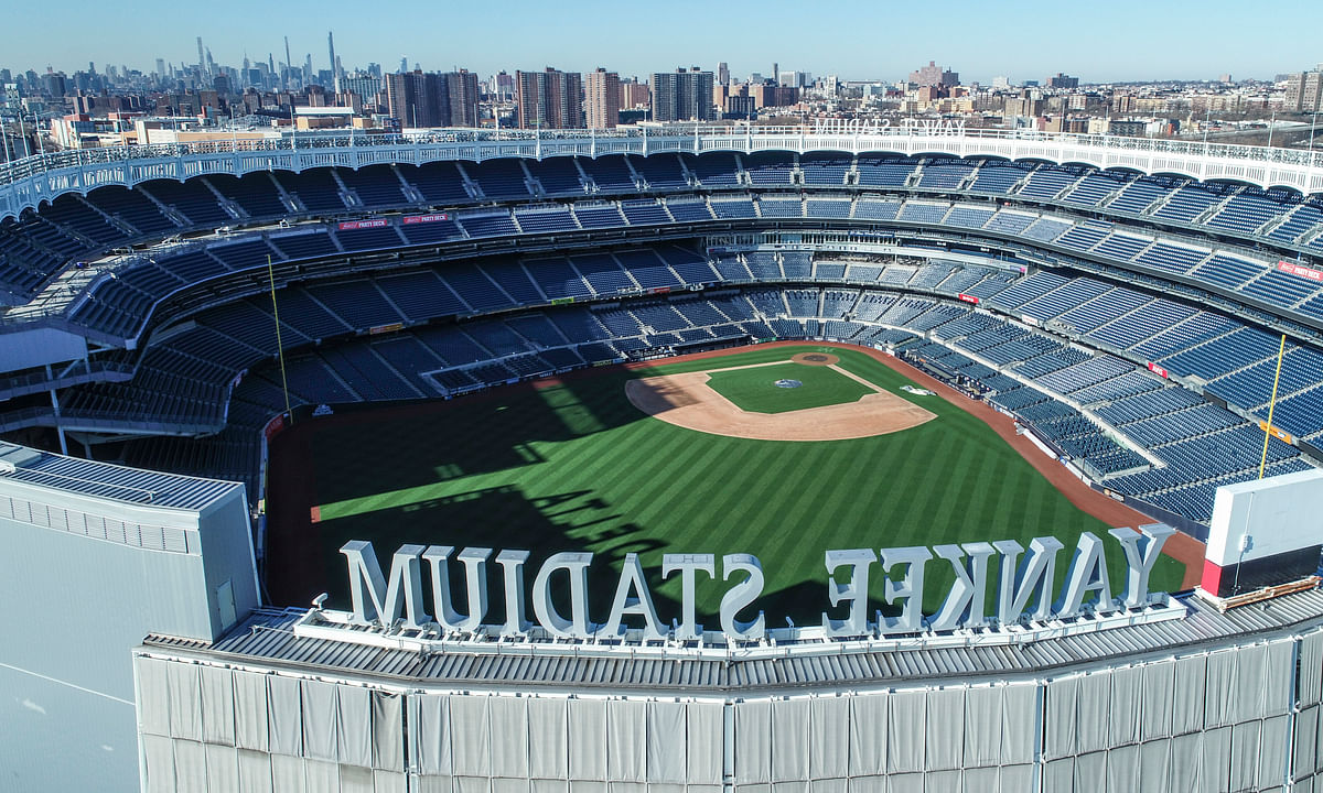 This March 26, 2020 file photo shows an empty Yankee Stadium on opening day due to COVID-19 coronavirus restrictions in the Bronx borough of New York. The Yankees and Mets will train in New York.