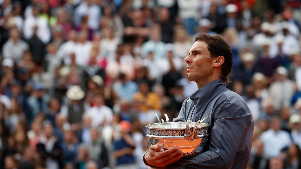 In this June 9, 2019, file photo, Spain's Rafael Nadal celebrates his record 12th French Open tennis tournament title after winning the men's final against Austria's Dominic Thiem at Roland Garros stadium in Paris. If not for the coronavirus pandemic, the second week of the French Open this week would have had fourth-round matches, quarterfinals, semifinals and the final for men and women. Nadal could have been trying to add to his 12 trophies at Roland Garros.