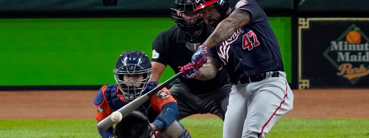 In this Oct. 30, 2019, file photo, Washington Nationals' Howie Kendrick hits a two-run home run against the Houston Astros during the seventh inning of Game 7 of the baseball World Series in Houston.