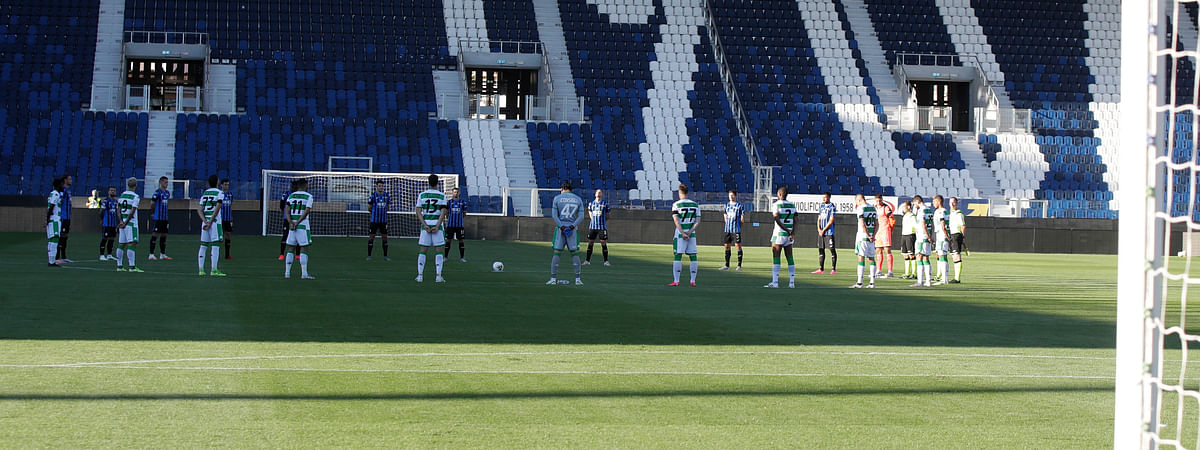 Players observe a minute of silence to honor the victims of coronavirus, prior to the Serie A soccer match between Atalanta and Sassuolo at the Gewiss Stadium in Bergamo, Italy, Sunday, June 21, 2020. Atalanta is playing its first match in Bergamo since easing of lockdown measures, in the area that has been the epicenter of the hardest-hit province of Italy's hardest-hit region, Lombardy, the site of hundreds of COVID-19 deaths.