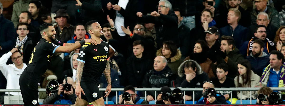 In this Wednesday, Feb. 26, 2020 file photo, Manchester City's Gabriel Jesus, right, celebrates after scoring his side's opening goal during the Champions League, round of 16, first leg soccer match between Real Madrid and Manchester City at the Santiago Bernabeu stadium in Madrid, Spain.