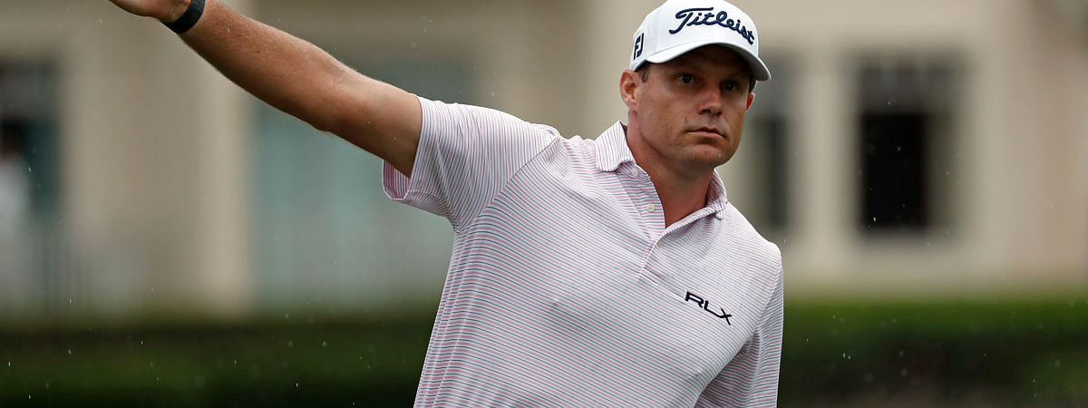 In this photo taken Thursday, June 18, 2020 Nick Watney signals after a tee shot during the first round of the RBC Heritage Golf tournament at Harbour Town Golf Links in Hilton Head, S.C. Watney has tested positive for coronavirus and did not play in Friday's round. (AP Photo/Gerry Broome)