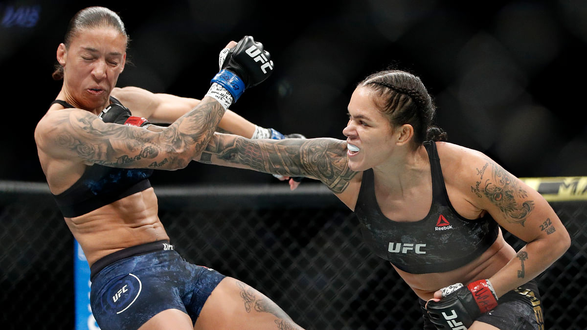 This Dec. 14, 2019, file photo shows Amanda Nunes, right, hitting Germaine de Randamie in a mixed martial arts women's bantamweight championship bout at UFC 245, in Las Vegas.