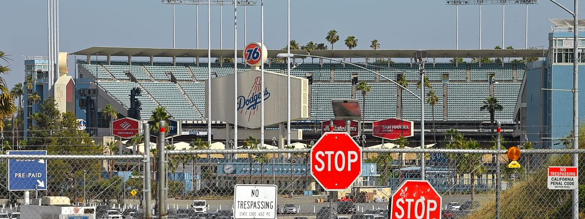 Dodger Stadium stands behind locked gates Wednesday, June 24, 2020, in Los Angeles. By the time Major League Baseball returns in late July, it will have been more than four months since teams last played. The season is now going to be a 60-game sprint to the finish, held in ballparks without fans and featuring some unusual rules.