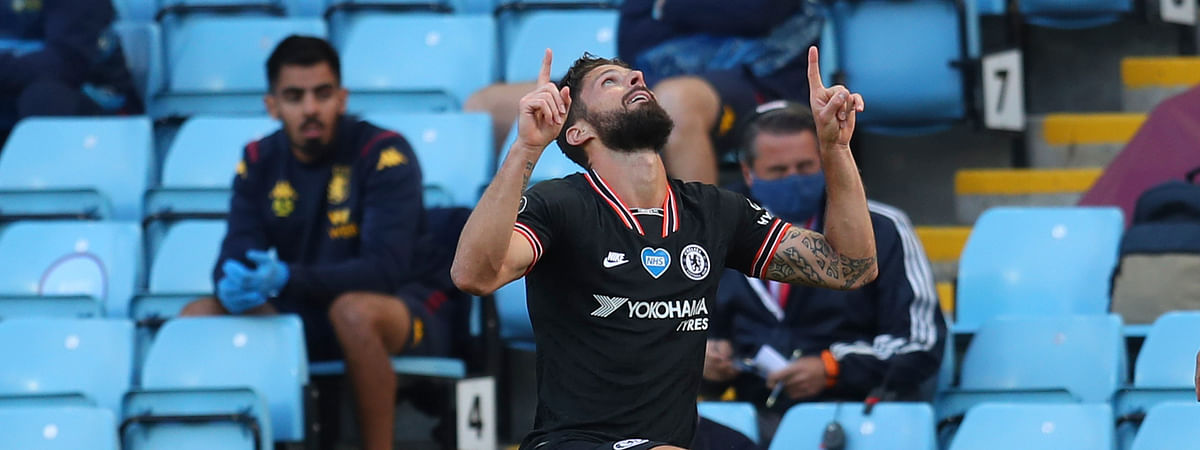 Chelsea's Olivier Giroud celebrates after scoring his side's second goal during the English Premier League soccer match between Aston Villa and Chelsea at the Villa Park stadium in Birmingham, England, Sunday, June 21, 2020.