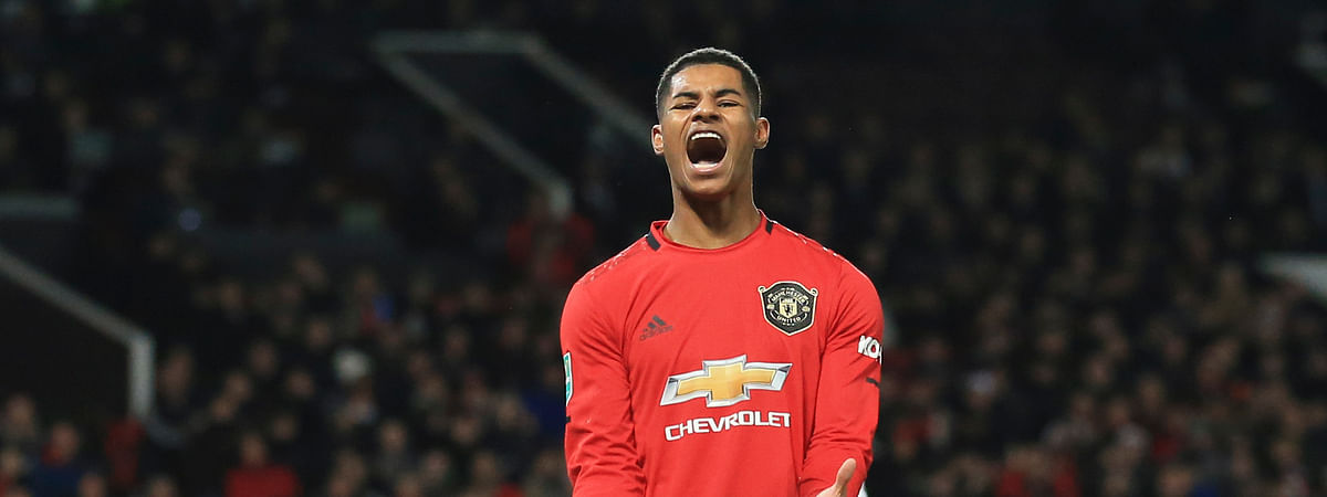 In this Wednesday, Dec. 18, 2019 file photo Manchester United's Marcus Rashford, reacts during the English League Cup quarter final soccer match between Manchester United and Colchester United at Old Trafford in Manchester, England.