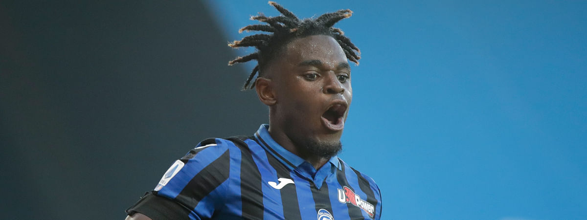 Atalanta's Duvan Zapata celebrates after scoring his side's fourth goal during the Serie A soccer match between Atalanta and Sassuolo at the Gewiss Stadium in Bergamo, Italy, Sunday, June 21, 2020. Atalanta is playing its first match in Bergamo since easing of lockdown measures, in the area that has been the epicenter of the hardest-hit province of Italy's hardest-hit region, Lombardy, the site of hundreds of COVID-19 deaths.