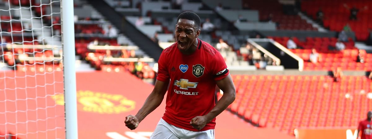 Manchester United's Anthony Martial celebrates after scoring his side's third goal during the English Premier League soccer match between Manchester United and Sheffield United at Old Trafford in Manchester, England, Wednesday, June 24, 2020.
