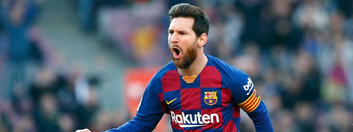 In this Saturday, Feb. 22, 2020 file photo, Barcelona's Lionel Messi celebrates after scoring his side's opening goal during a Spanish La Liga soccer match between Barcelona and Eibar at the Camp Nou stadium in Barcelona, Spain.