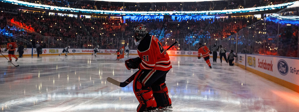 In this Feb. 20, 2020, file photo, Edmonton Oilers goalie Mike Smith warms up for the team's NHL hockey game against the Winnipeg Jets in Edmonton, Alberta. Deputy Commissioner Bill Daly told The Associated Press on Sunday, July 5, that the NHL and NHL Players' Association have agreed on protocols to resume the season.