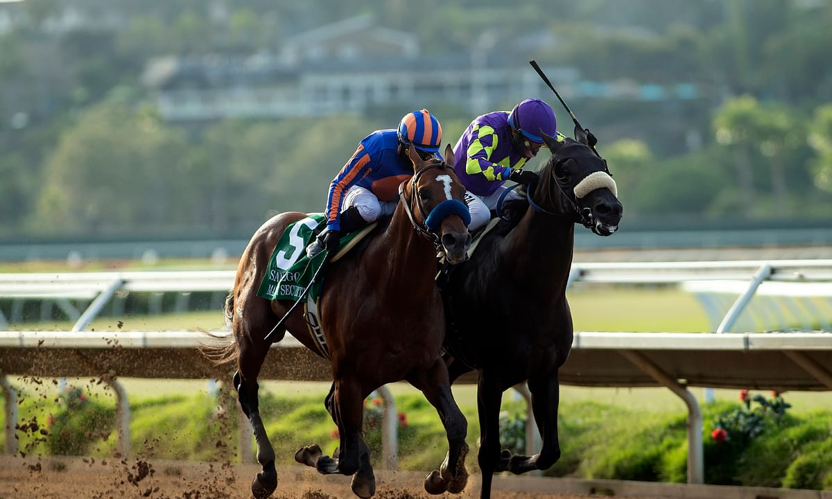 In this image provided by Benoit Photo, Maximum Security, left, with Abel Cedillo aboard, overpowers Midcourt, right, with Victor Espinoza aboard, to win the Grade II, $150,000 San Diego Handicap horse race Saturday, July 25, 2020, at Del Mar Thoroughbred Club in Del Mar, Calif.