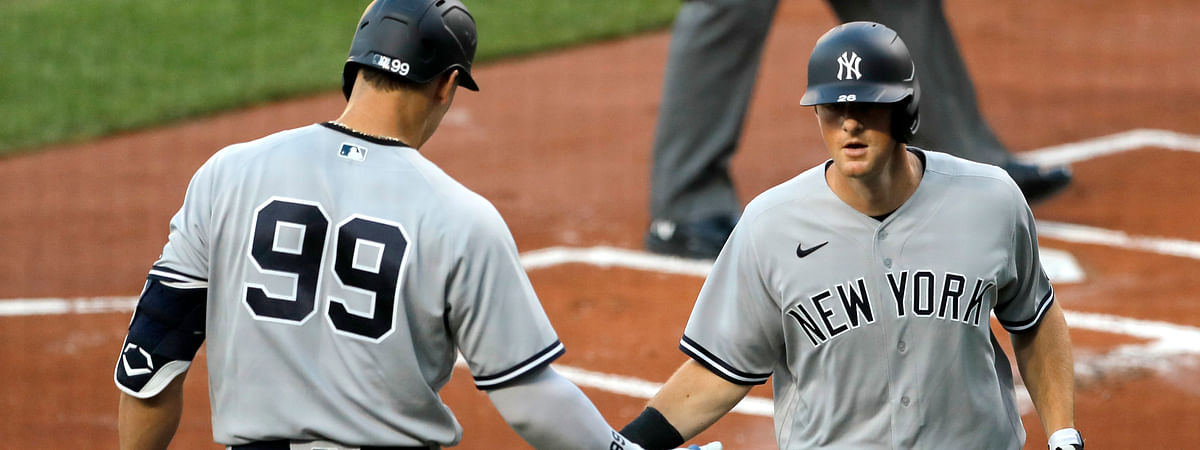 New York Yankees' Aaron Judge (99) greets DJ LeMahieu, right, after LaMahieu hit a solo home run off Baltimore Orioles starting pitcher Asher Wojciechowski during the first inning of a baseball game, Wednesday, July 29, 2020, in Baltimore.