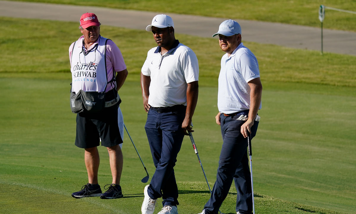 From right, Zac Blair, Harold Varner III and caddie Rick Wynn observe a moment of silence to pay their respects to the memory of George Floyd on the 16th hole during the second round of the Charles Schwab Challenge golf tournament at the Colonial Country Club in Fort Worth, Texas, Friday, June 12, 2020. Varner is one of Kern's Longshot picks for the Workday Charity Open.