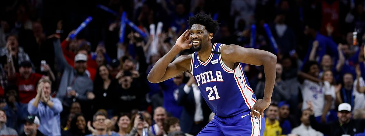 In this Feb. 24, 2020, file photo, Philadelphia 76ers' Joel Embiid celebrates after a three-point basket during the second half of an NBA basketball game against the Atlanta Hawks in Philadelphia. 76ers coach Brett Brown says All-Stars Ben Simmons and Joel Embiid are healthy for the NBA restart.