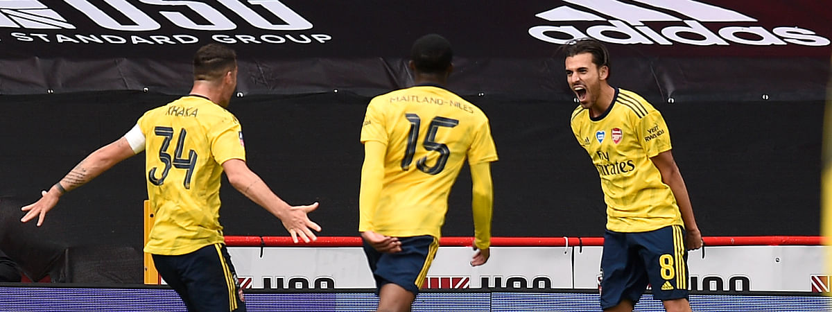 Arsenal's Dani Ceballos, right, celebrates with his teammates after scoring his side's second goal during the FA Cup sixth round soccer match between Sheffield United and Arsenal at Bramall Lane in Sheffield, England, Sunday, June 28, 2020.