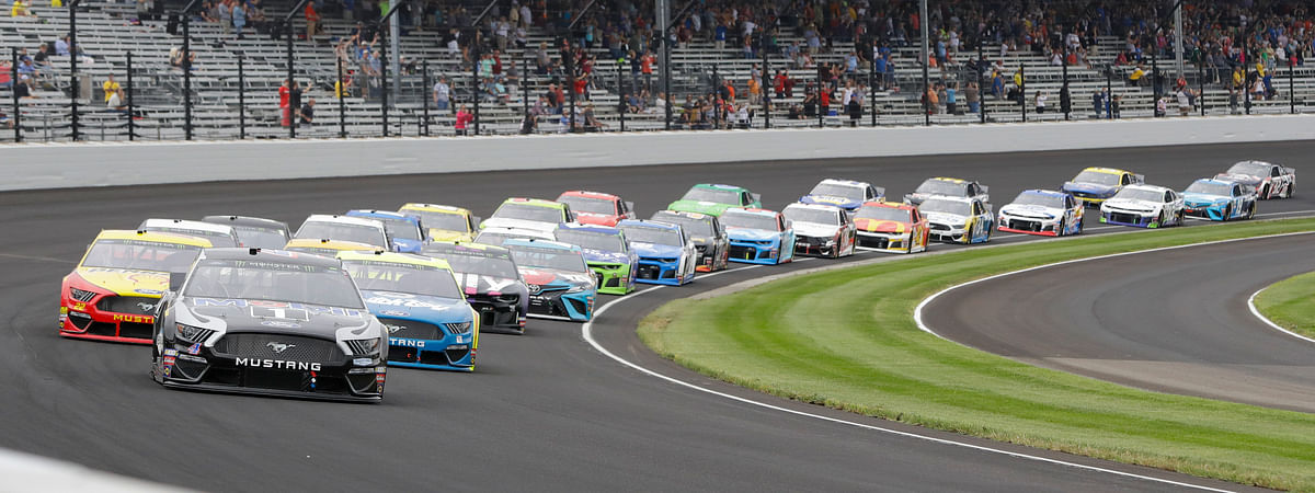 In this Sept. 8, 2019, file photo, Kevin Harvick leads the field through the first turn on the start of the NASCAR Brickyard 400 auto race at Indianapolis Motor Speedway in Indianapolis. The once frosty schism between the two biggest racing series in the United States has thawed and NASCAR's elite Cup Series will share a venue with IndyCar on the same weekend for the first time in history.