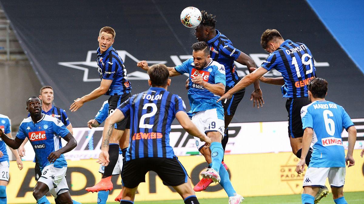 Atalanta's Duvan Zapata, top center, heads the ball ahead of Napoli's Nikola Maksimovic during a Serie A soccer match between Atalanta and Napoli, at Bergamo's Stadium, northern Italy, Thursday, July 2, 2020.