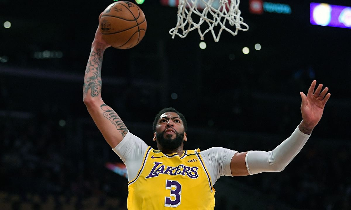 In this Tuesday, March 3, 2020, file photo, Los Angeles Lakers forward Anthony Davis shoots during the first half of an NBA basketball game against the Philadelphia 76ers in Los Angeles.