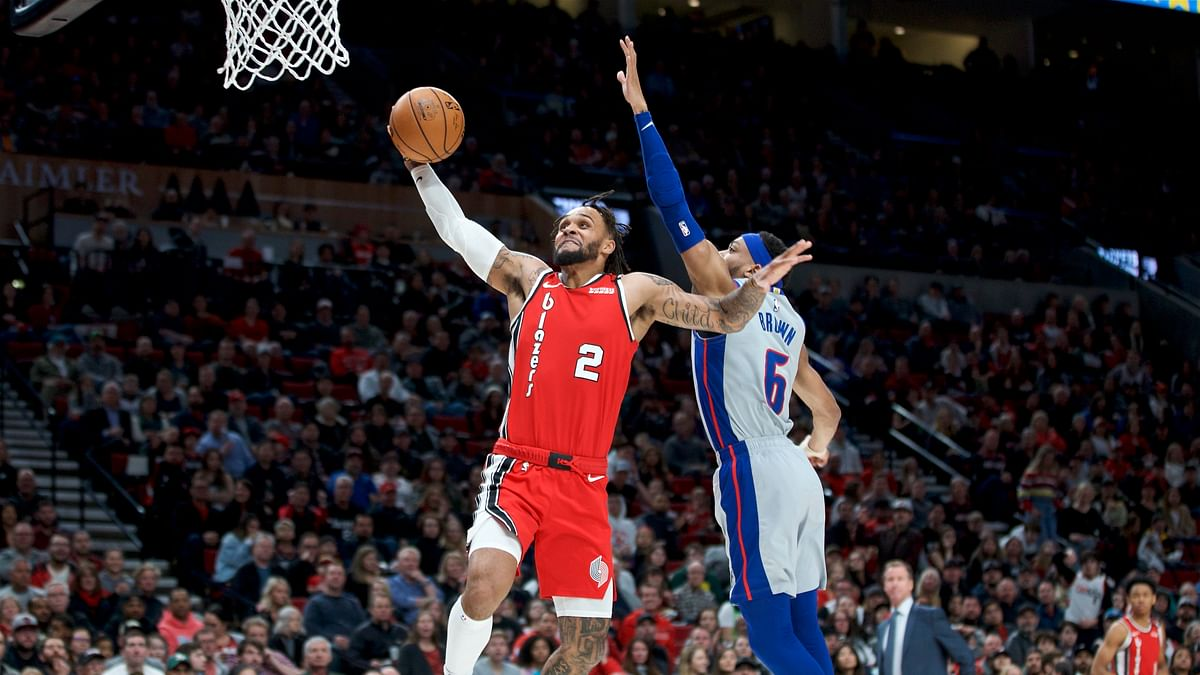 In this Feb. 23, 2020, file photo, Portland Trail Blazers guard Gary Trent Jr., left, shoots over Detroit Pistons guard Bruce Brown during the first half of an NBA basketball game in Portland, Ore. Trent showed flashes of his potential in the month prior to the pandemic, as he scored 22 against Miami on Feb. 9, 20 against Indiana on Feb. 27 and 24 against Orlando on March 2.