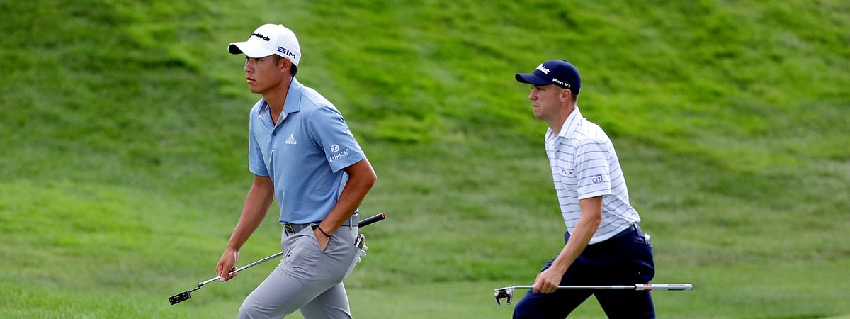 Collin Morikawa, left, and Justin Thomas walk up the 18th green during the third round of the Workday Charity Open golf tournament, Saturday, July 11, 2020, in Dublin, Ohio.