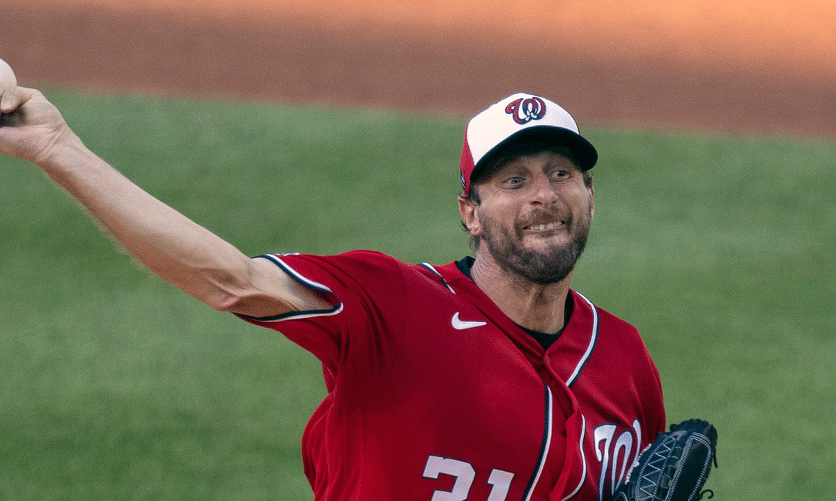 In this July 13, 2020, file photo Washington Nationals starting pitcher Max Scherzer throws during a baseball training camp workout at Nationals Park in Washington. Scherzer, Stephen Strasburg and the rest of the Nationals head into the 2020 season hoping to do something no major league club has done in quite some time: win back-to-back World Series.