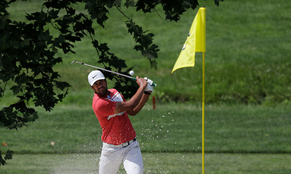 Tony Finau hits from a bunker toward the fourth green during the second round of the Memorial golf tournament, Friday, July 17, 2020, in Dublin, Ohio.