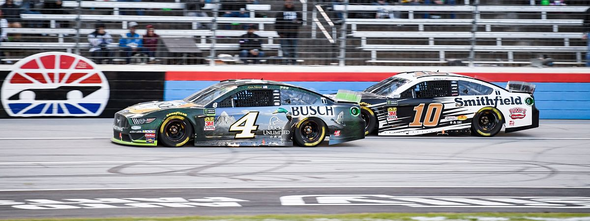 In this Nov. 3, 2019, file photo, Kevin Harvick (4) and Aric Almirola (10) battle for position during a NASCAR Cup Series auto race at Texas Motor Speedway, in Fort Worth, Texas.