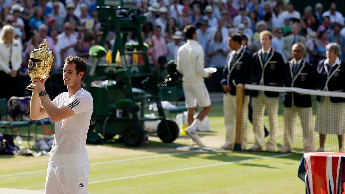 In this July 7, 2013, file photo, Andy Murray of Britain poses with the trophy after defeating Novak Djokovic of Serbia in the men's singles final match at the All England Lawn Tennis Championships in Wimbledon, London.