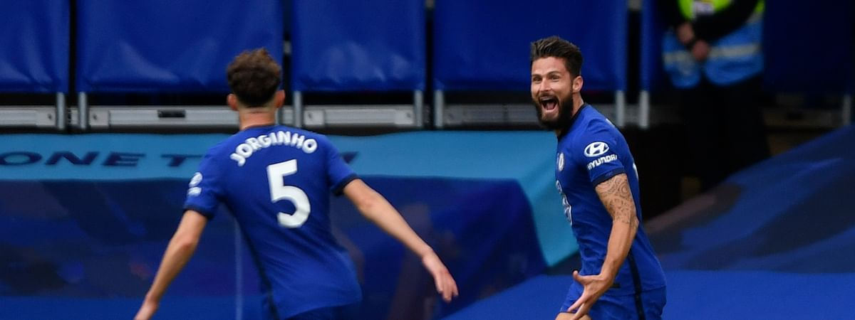 Chelsea's Olivier Giroud, right, celebrates with teammate Jorginho after scoring his sides second goal during the English Premier League soccer match between Chelsea and Wolverhampton Wanderers at Stamford Bridge, in London, Sunday July 26, 2020.