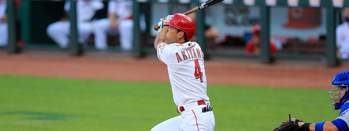 Cincinnati Reds' Shogo Akiyama hits a fly ball for an out during the third inning of a baseball game against the Chicago Cubs in Cincinnati, Tuesday, July 28, 2020.