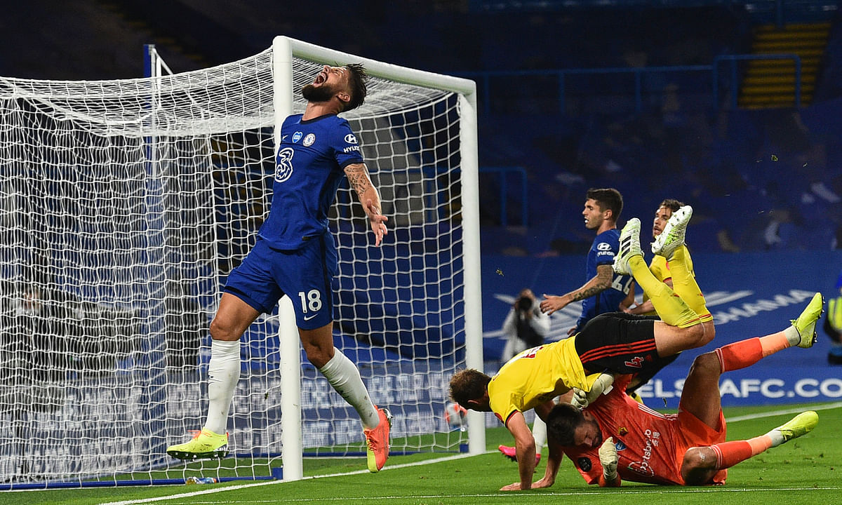 Chelsea's Olivier Giroud, left, reacts after missing a chance to score during the English Premier League soccer match between Chelsea and Watford at the Stamford Bridge stadium in London, Saturday, July 4, 2020.