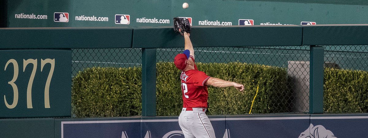 Phillies' left fielder Kyle Garlick can't reach a home run by the Nationals' Jake Noll on Saturday