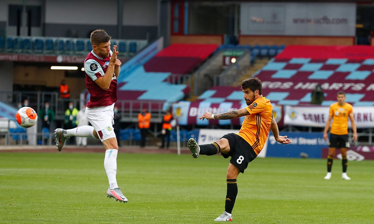 Wolverhampton Wanderers' Ruben Neves shoots at goal during the English Premier League soccer match between Burnley and Wolverhampton Wanderers at the Turf Moor stadium in Burnley, England, Wednesday, July 15, 2020.