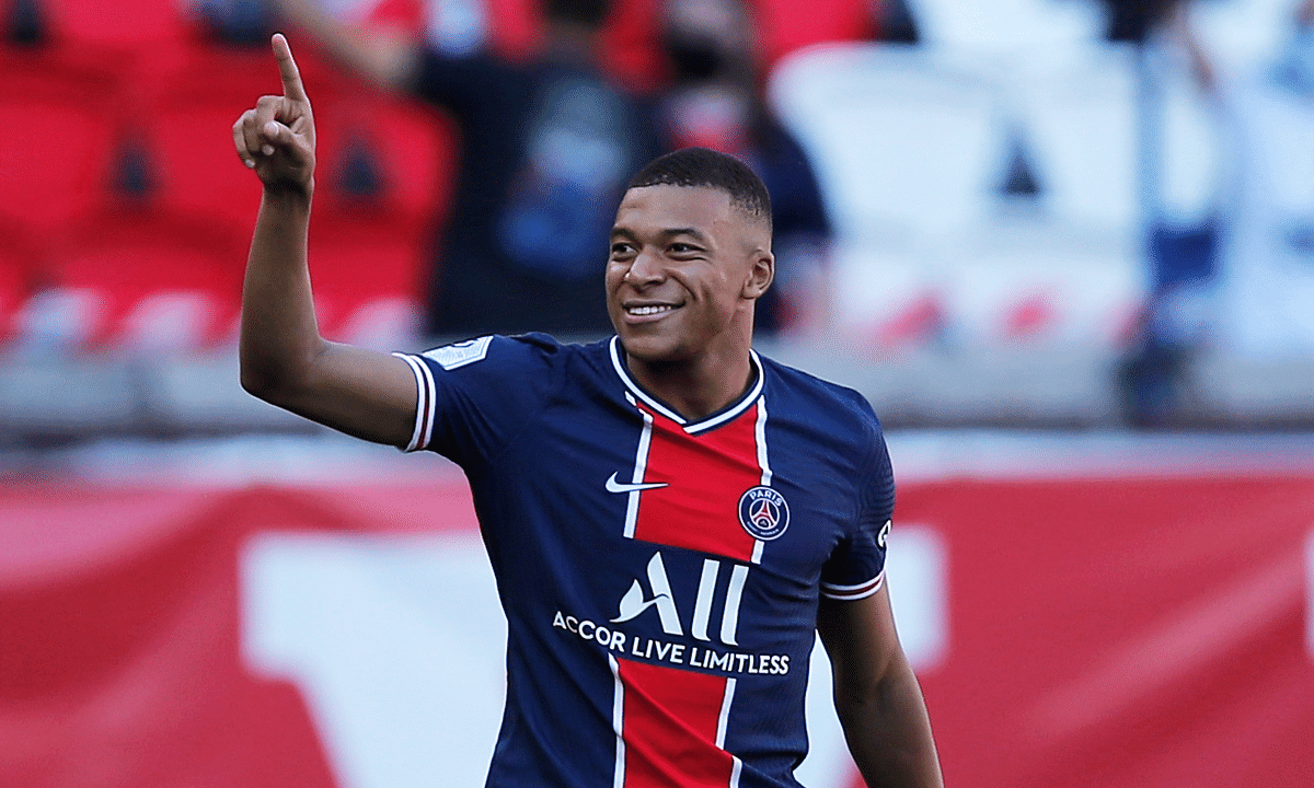 PSG's Kylian Mbappe reacts after scoring his side first goal during a friendly soccer match between Paris Saint Germain and Glasgow Celtic FC at Parc des Princes Stadium in Paris, Tuesday, July 21, 2020.