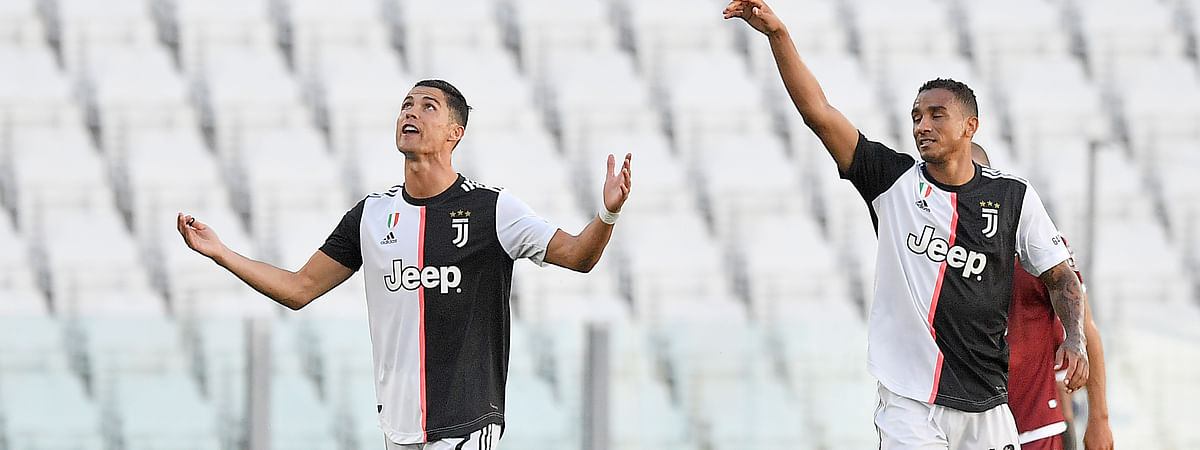 Juventus' Cristiano Ronaldo, left, celebrates scoring his side's 3rd goal on a free-kick, during the Serie A soccer match between Juventus and Torino, at the Allianz Stadium in Turin, Italy, Saturday, July 4, 2020.