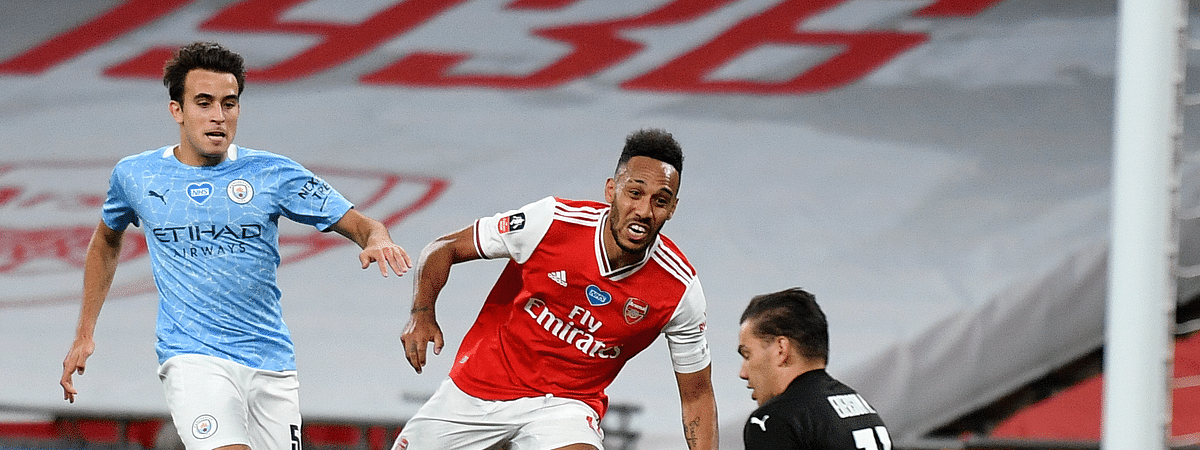 Arsenal's Pierre-Emerick Aubameyang, centre, scores his team's second goal during the FA Cup semifinal soccer match between Arsenal and Manchester City at Wembley in London, England, Saturday, July 18, 2020.