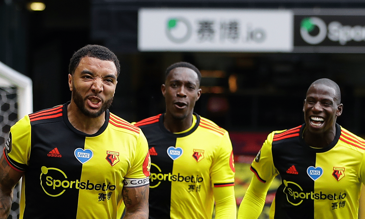Watford's Troy Deeney, left, celebrates with teammates after scores his side's second goal from the penalty spot during the English Premier League soccer match between Watford and Newcastle at the Vicarage Road Stadium in Watford, England, Saturday, July 11, 2020.