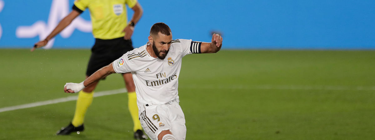 Real Madrid's Karim Benzema shoots to score a penalty against Deportivo Alaves during the Spanish La Liga soccer match between Real Madrid and Deportivo Alaves at the Alfredo di Stefano stadium in Madrid, Spain, Friday, July 10, 2020.