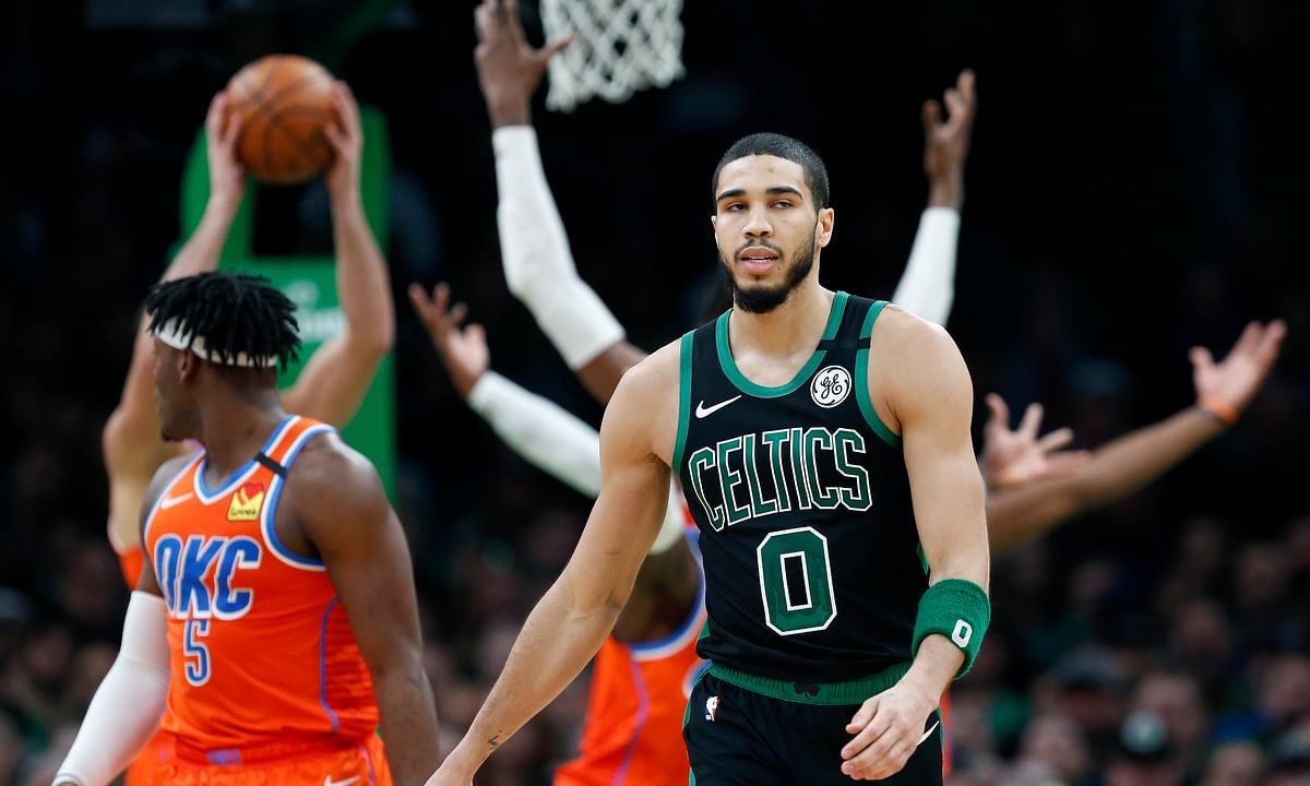 FILE - In this March 8, 2020, file photom, Boston Celtics' Jayson Tatum (0) walks on the court during the second half of an NBA basketball game against the Oklahoma City Thunder in Boston. Before the pandemic forced the NBA to pause its season, the Celtics were a team eager to figure out what they could be. It also remains to be seen whether fellow All-Star Jayson Tatum will be able to play at the high level he was before the season was suspended.(AP Photo/Michael Dwyer, File)