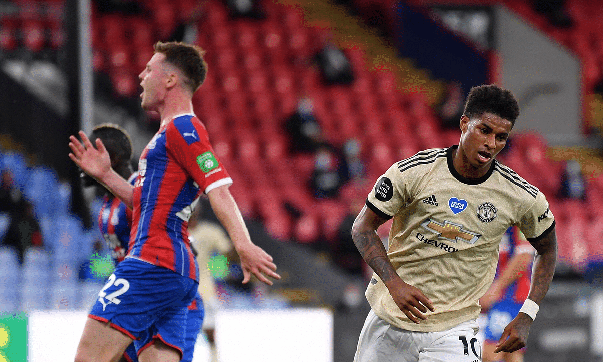 Manchester United's Marcus Rashford trust away after scoring the opening goal during the English Premier League soccer match between Crystal Palace and Manchester United at Selhurst Park in London, England, Thursday, July 16, 2020.