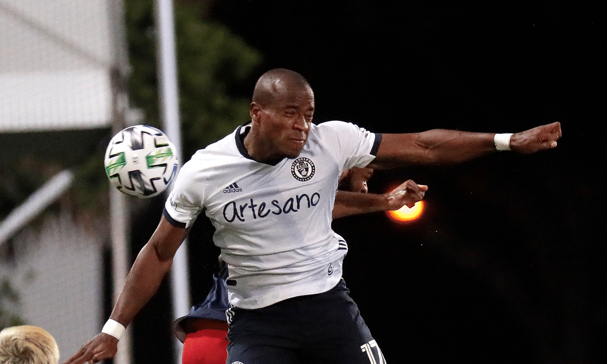 Philadelphia Union forward Sergio Santos (17) goes up for a header against New England Revolution defender Andrew Farrell during the first half of an MLS soccer match, Saturday, July 25, 2020, in Kissimmee, Fla.