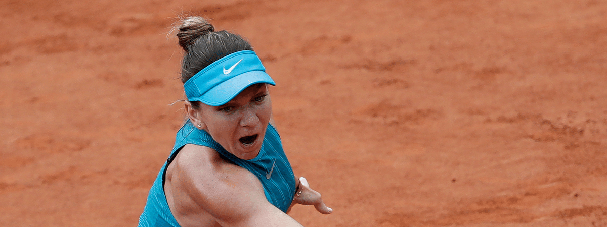 In this May 30, 2018 file photo Romania's Simona Halep slams a forehand to Alison Riske of the U.S. during their first round match of the French Open tennis tournament at the Roland Garros stadium, in Paris. This year's Palermo Ladies Open, the Aug. 3-9 event marking the return of tour-level tennis following a five-month break for the coronavirus pandemic, will be like no other.