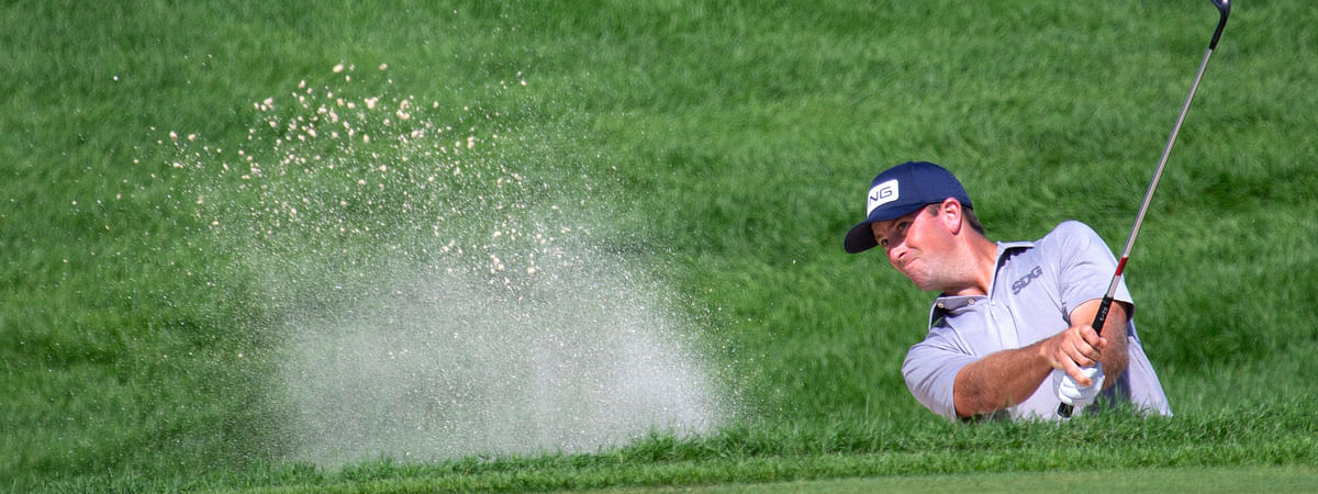 Michael Thompson hits out of a bunker on the 12th hole during the final round of the 3M Open golf tournament in Blaine, Minn., Sunday, July 26, 2020.