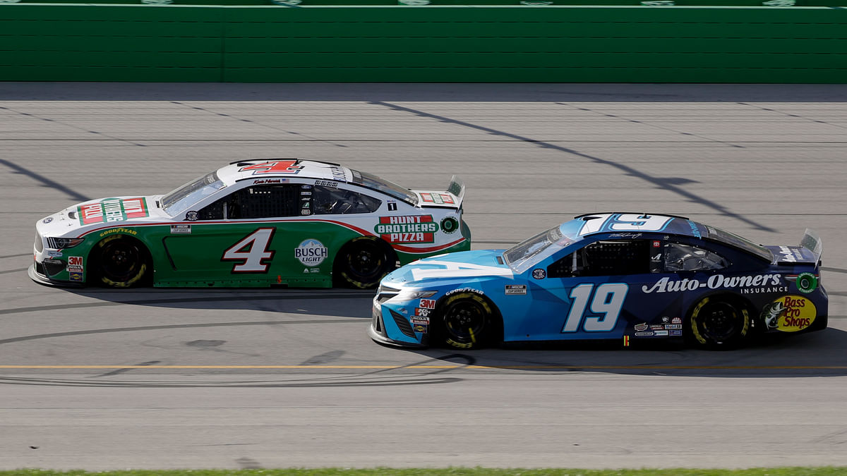 Kevin Harvick (4) and Martin Truex Jr. (19) run during a NASCAR Cup Series auto race Sunday, July 12, 2020, in Sparta, Ky.