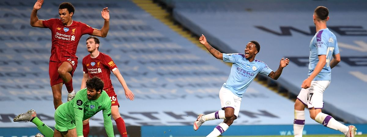 Manchester City's Raheem Sterling, second right, celebrates after his team's fourth goal during the English Premier League soccer match between Manchester City and Liverpool at Etihad Stadium in Manchester, England, Thursday, July 2, 2020. (AP Photo/