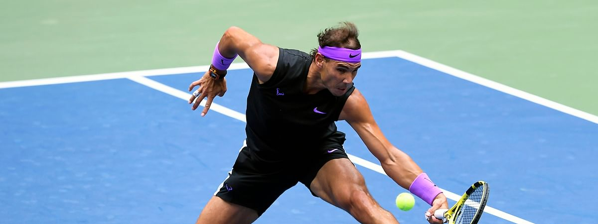 In this Sept. 8, 2019, file photo, Rafael Nadal, of Spain, returns a shot to Daniil Medvedev, of Russia, during the men's singles final of the U.S. Open tennis championships in New York. Defending champion Rafael Nadal will skip the U.S. Open because of the coronavirus pandemic.