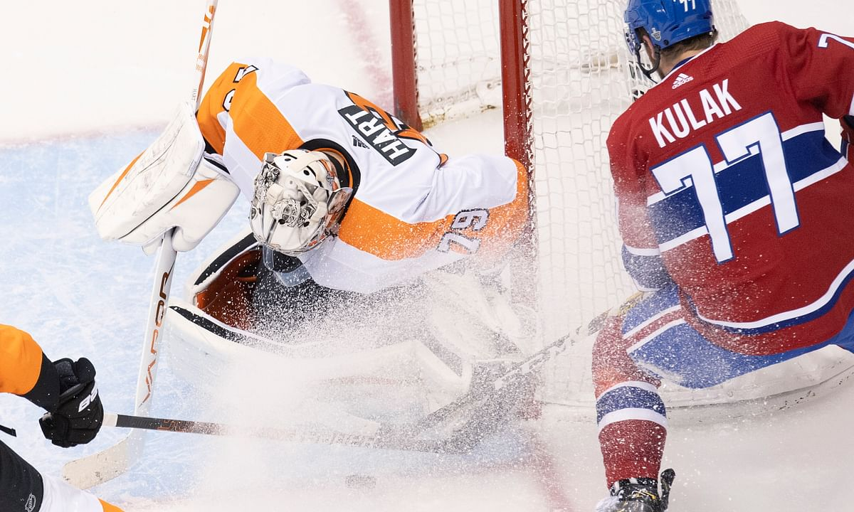 Philadelphia Flyers goaltender Carter Hart (79) makes a save on Montreal Canadiens defenceman Brett Kulak (77) during the second period of an NHL Eastern Conference Stanley Cup first-round playoff game in Toronto, Ontario, Tuesday, Aug. 18, 2020.
