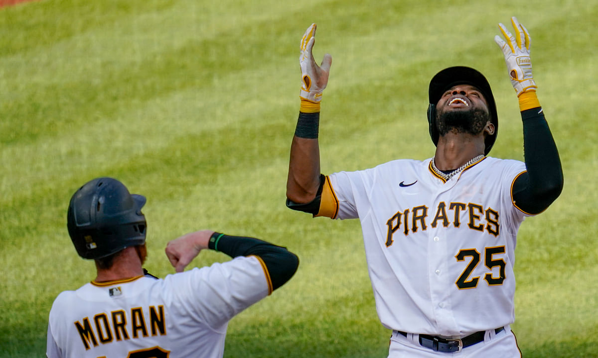 Pittsburgh Pirates' Gregory Polanco, right, celebrates with Colin Moran (19) after driving Moran in with a two-run home run against the Milwaukee Brewers in the fourth inning of a baseball game, Saturday, Aug. 22, 2020, in Pittsburgh.