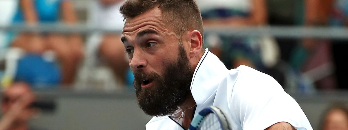 FILE - In this Wednesday, Jan. 22, 2020 file photo, France's Benoit Paire makes a backhand return to Croatia's Marin Cilic during their second round singles match at the Australian Open tennis championship in Melbourne, Australia. Paire has tested positive for the coronavirus and was removed from the U.S. Open field, a person familiar with the situation told The Associated Press on Sunday, Aug. 30, 2020.